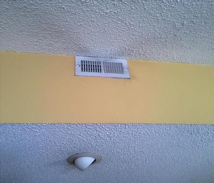 Smoke gathers near ceiling vent